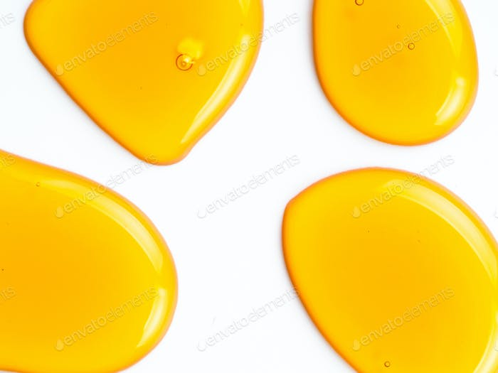 Honey drops abstract pattern, isolated on white