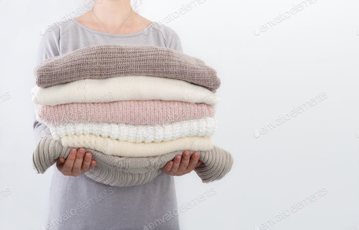 Woman holding knitted blankets