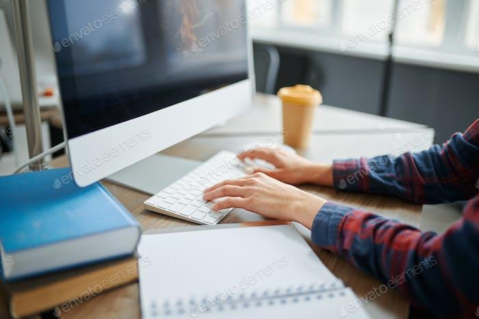 Female IT specialist hands on keyboard in office