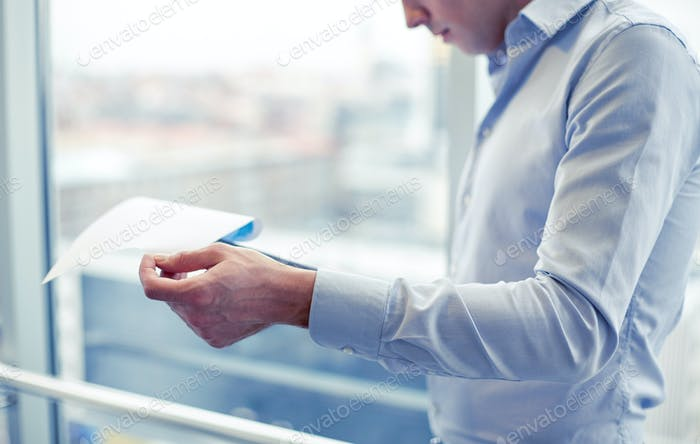 businessman with clipboard and papers in office