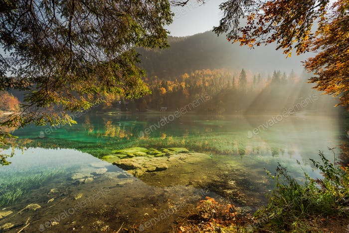 Clear water in Fusine lake with sunsine
