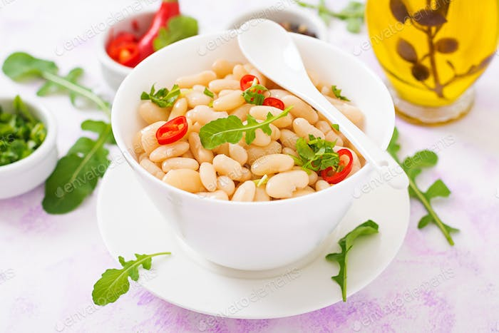 Boiled white beans in a bowl. Diet food. Healthy lifestyle. Sports nutrition.