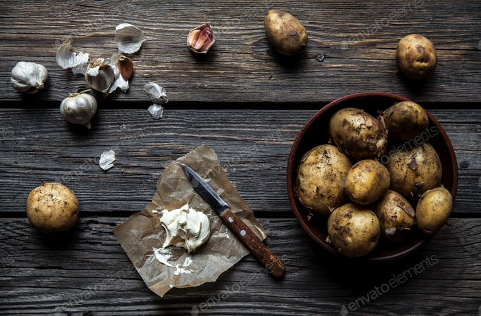 young boiled potatoes with dill and garlic