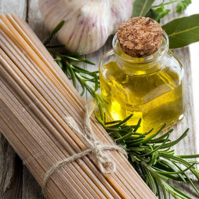 Whole wheat spaghetti, garlic, oilve oil and herbs