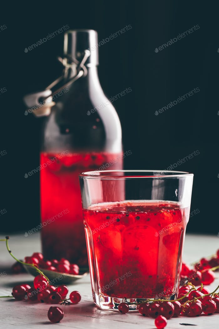 Glass of infused water with red currant