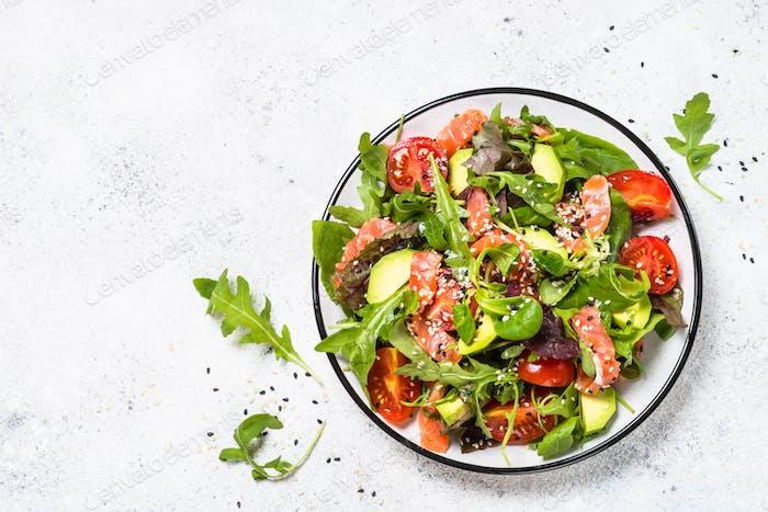 Salmon salad on white top view