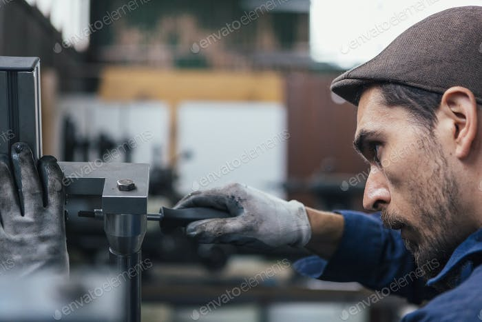 Close-up of man using screwdriver