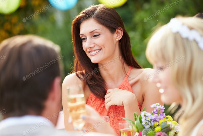Female Guest At Wedding Reception