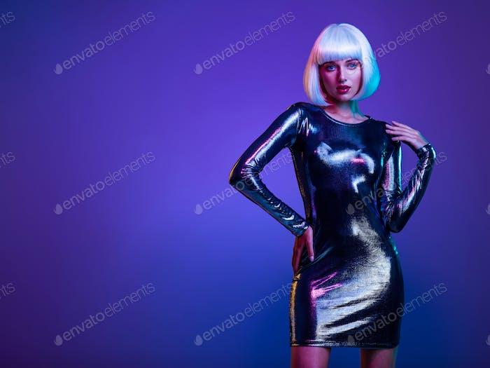 Glamour fashion girl . Stylish blonde in shiny dress.  beautiful  fashionable woman in shining dress