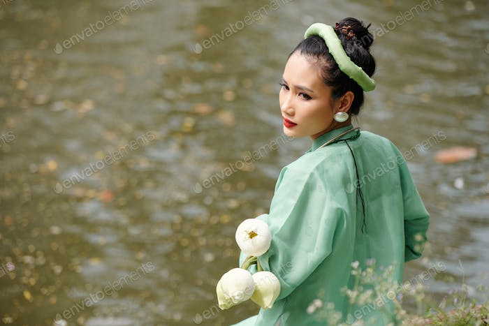 Attractive woman standing by water