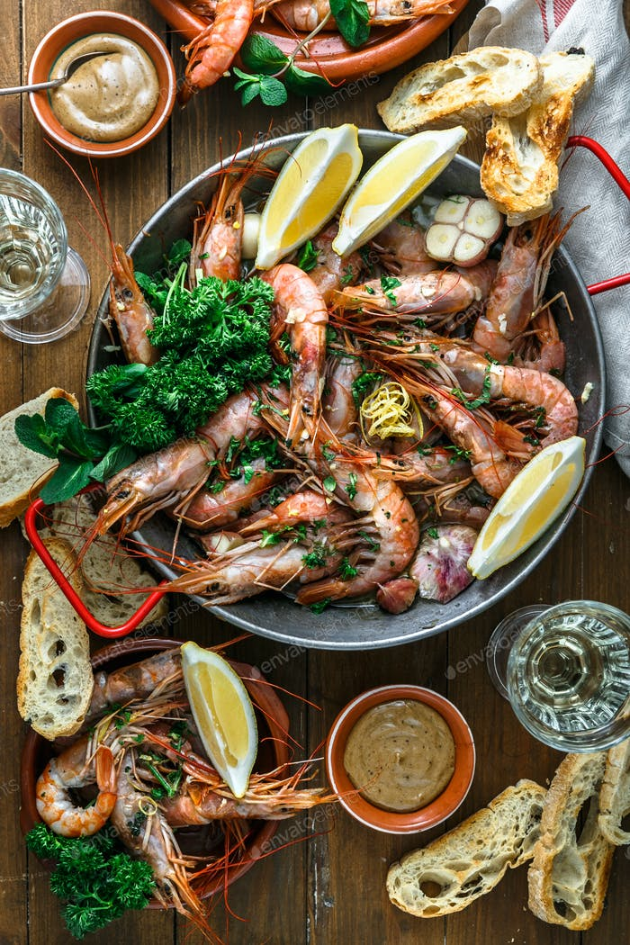 Prawns Shrimps roasted with lemon and garlic in iron pan. Top view.
