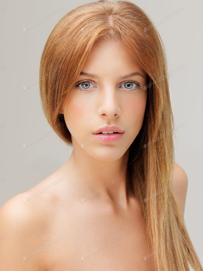 portrait young blonde woman with blue eyes
