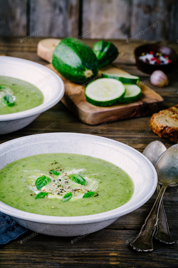 green vegetable cream soup puree with zucchini and basil
