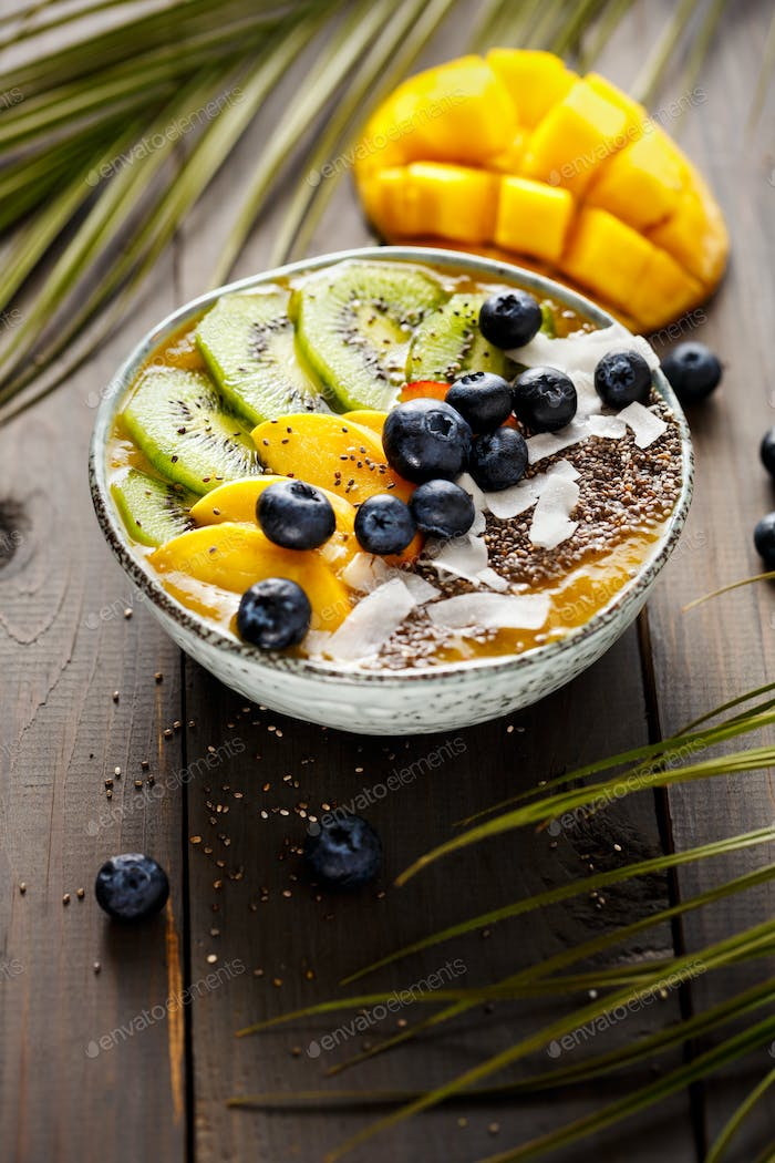 Mango smoothie bowl with kiwi fruit