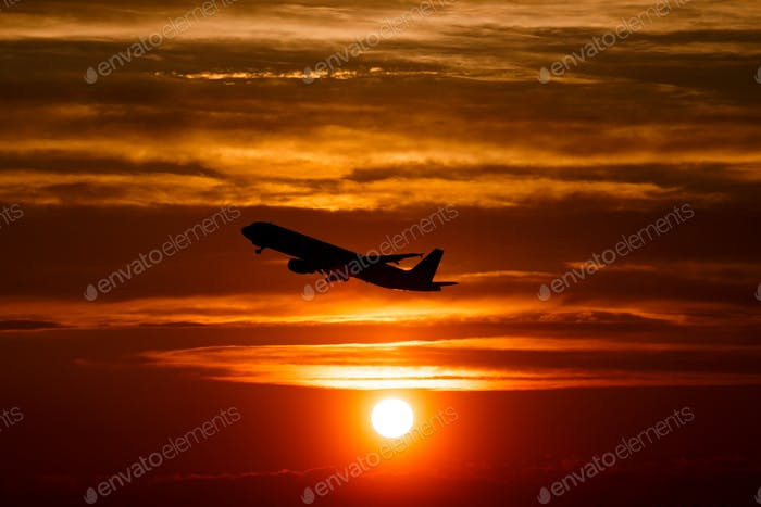 Silhouette of a big passenger  aircraft in sun light