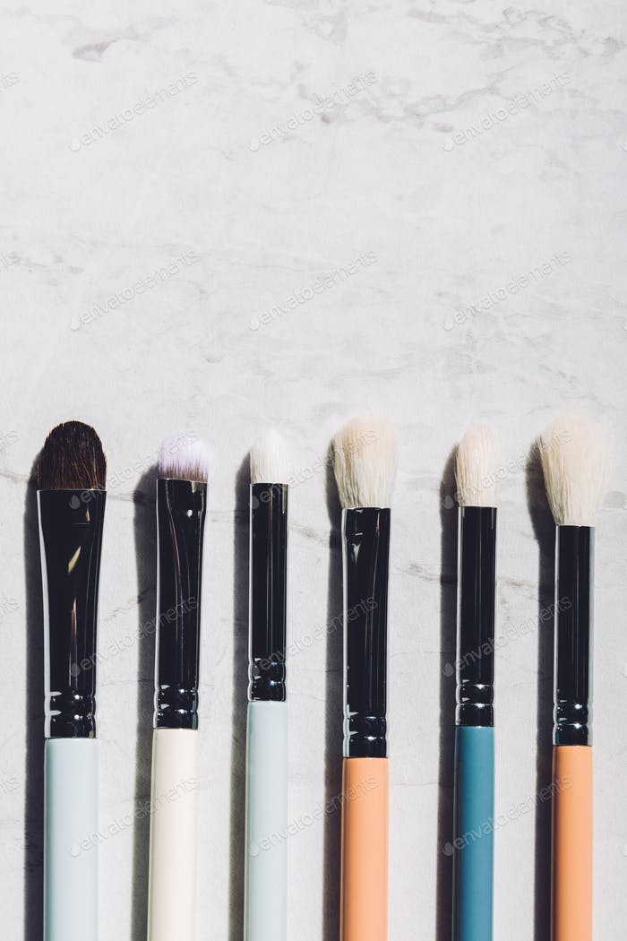 Six makeup brushes laying together.