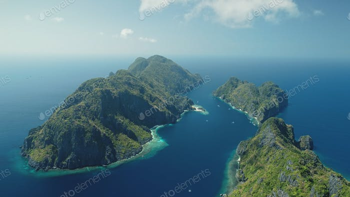 Tropic Mount Islands at ocean bay aerial view. Seascape of El Nido Islets, Philippines, Asia