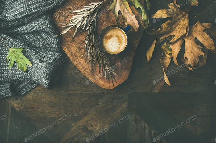 Autumn morning coffee concept with leaves and jamper