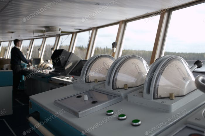 Navigational officer driving ship on the river