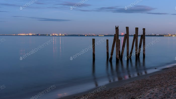Wooden piles in the Gulf of Gdansk in Poland at dusk
