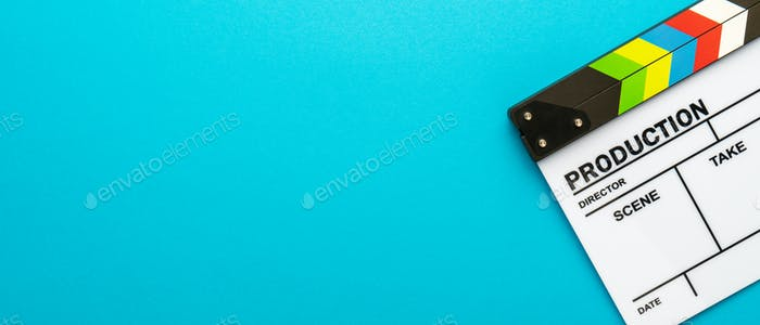 Top View Of White Clapperboard Over Turquoise Blue Background And Copy Space