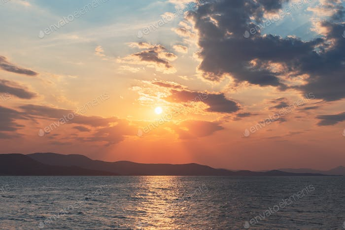 Sunset Over The Mountains And The Sea