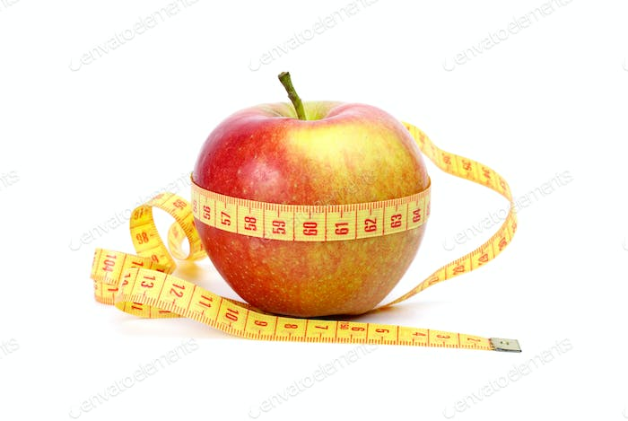 Yellow-red apple and measurement tape