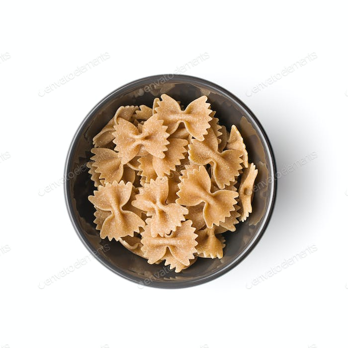 Wholewheat farfalle pasta. Tasty italian pasta in bowl.