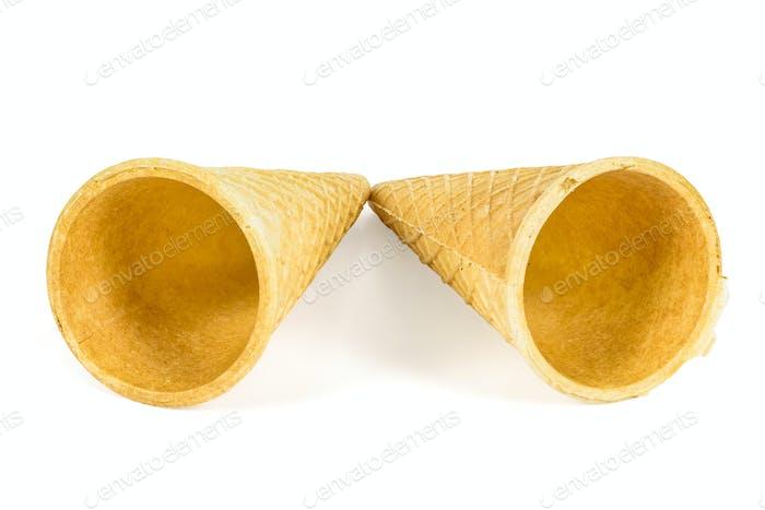 Two empty ice cream cones on white background