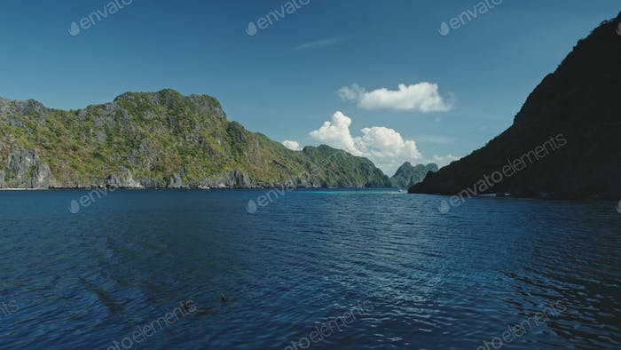 Tropical seascape at green cliff coast of Palawan Islands, El Nido, Philippines. Epic summer tourism