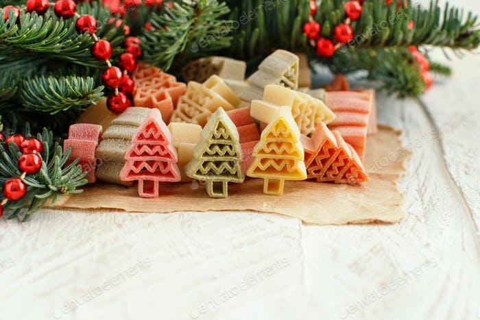 Tricolor fir tree shaped pasta and fir branches