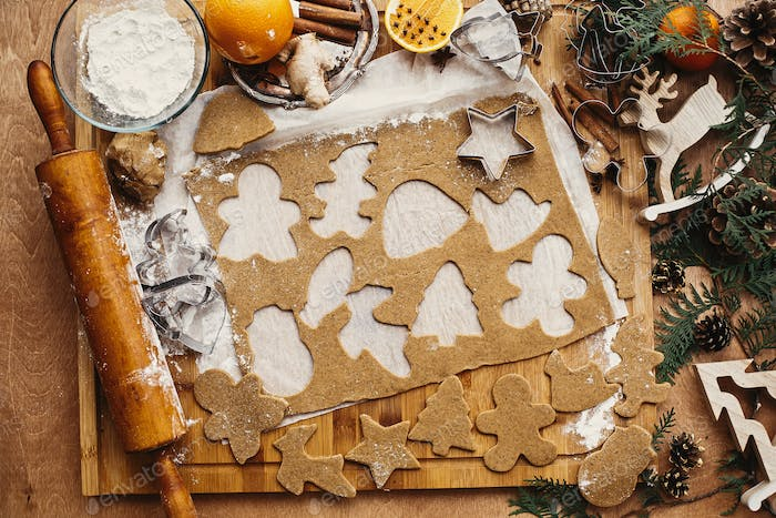 Making christmas gingerbread cookies, flat lay
