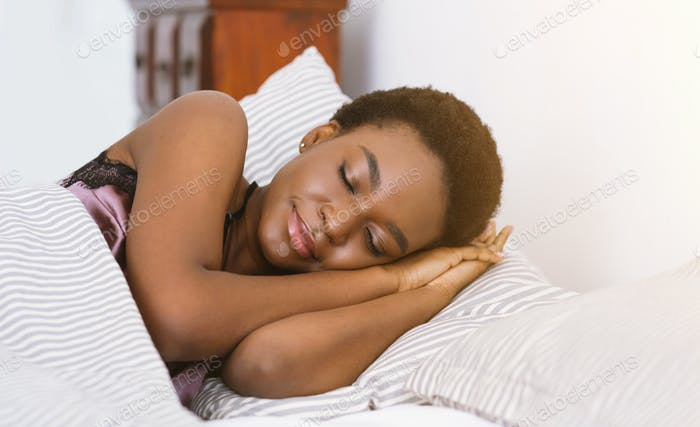 Healthy sleep. African american girl sleeping in bed