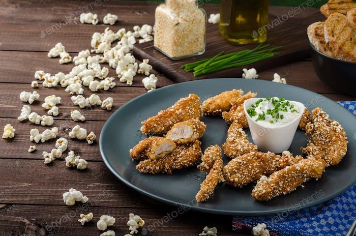 Chicken strips in popcorn breadcrumbs