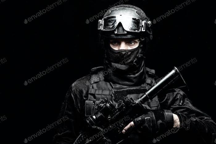 SWAT team fighter shoulder portrait on black