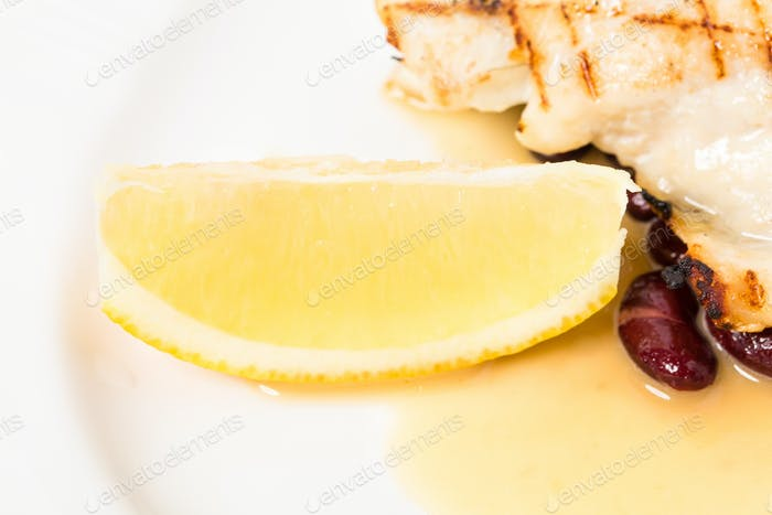 Delicious baked dorado fillet with lemon.