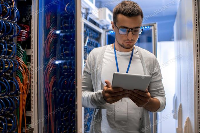 Modern Network Engineer Working with Supercomputer