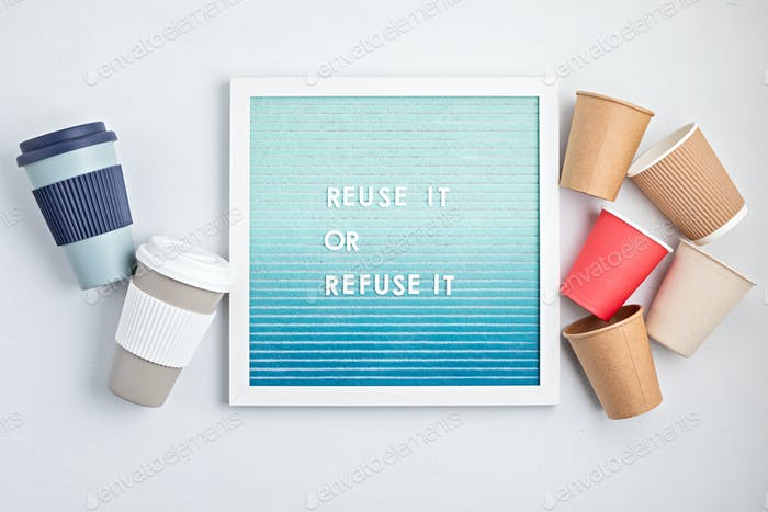 Reusable vs disposable coffee cups and letterboard with text reuse it or refuse it