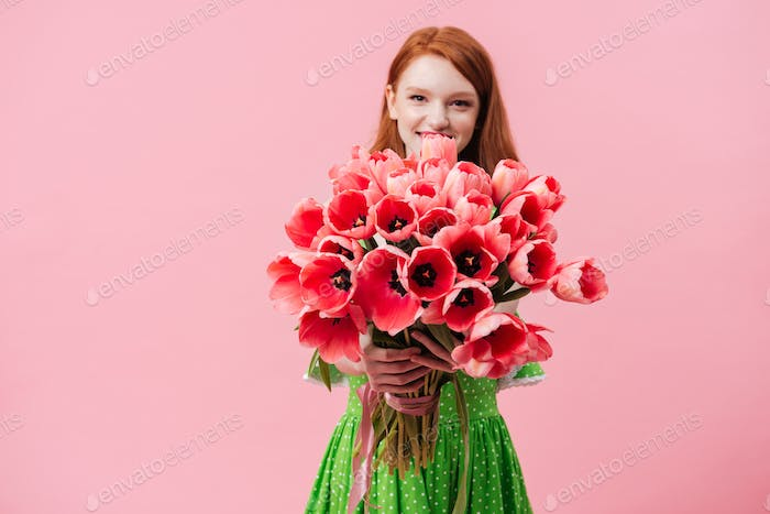 Positive girl holding tulips