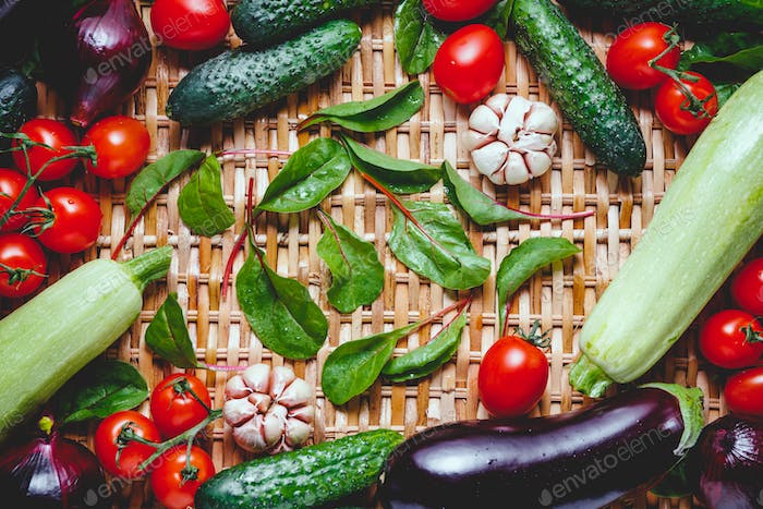 Various fresh vegetables on a rattan background. Healthy eating and cooking concept.