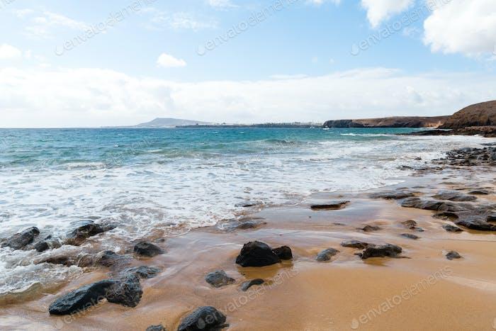 Panorama of beautiful beach and tropical sea of Lanzarote. Canaries