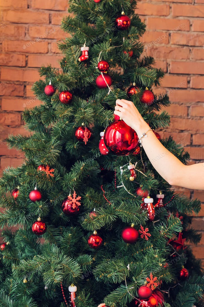 Close up of woman decorating Christmas tree