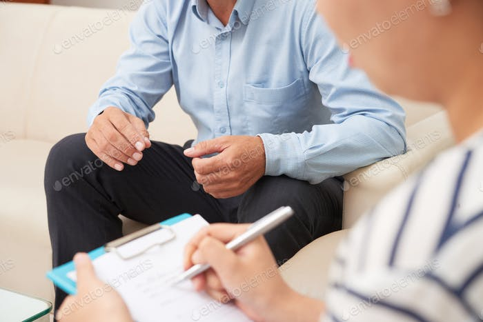 Man consulting with medical doctor or psychologist