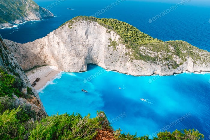Navagio beach from top at Zakynthos island, Greece. Stranded shipwreck in unique beautiful blue bay