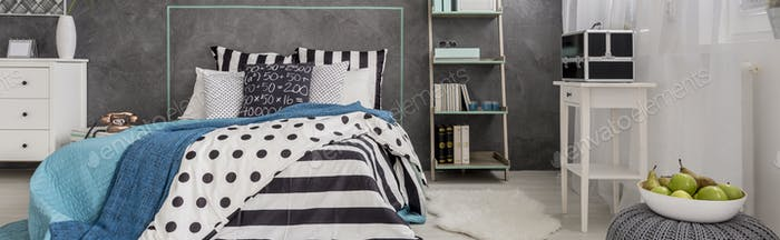 Bright bedroom with concrete wall