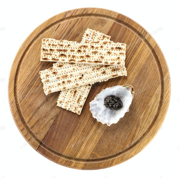 Black caviar and matzah on cutting board, with path