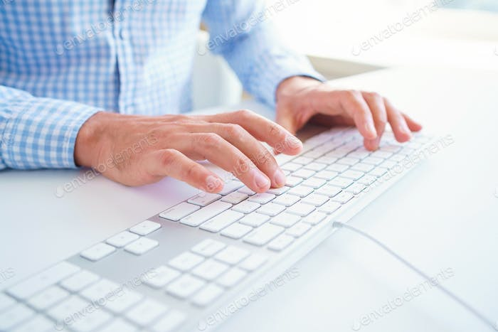 Men office worker typing on the keyboard