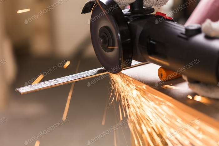Sparks during cutting of metal angle grinder