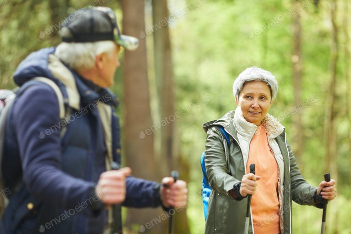 Senior Woman Enjoying Nordic Walk in Forest