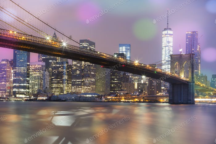 View of Brooklyn Bridge by night, NYC.